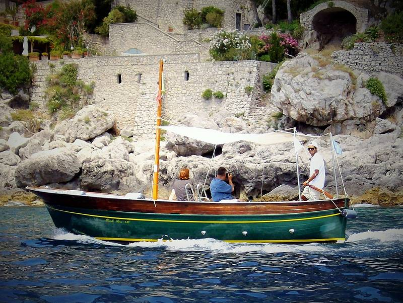 Book half day tour by gozzo boat around the isle of capri for Isle of capri tours