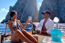 Wedding proposal on boat at sea of Capri